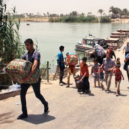 Displaced Iraqis are forced to flee their homes as fighters from the Islamic State consolidate their gains in Ramadi.