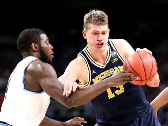 Moritz Wagner drives to the basket against Villanova's Eric Paschall during the national championship game April 2 in San Antonio.
