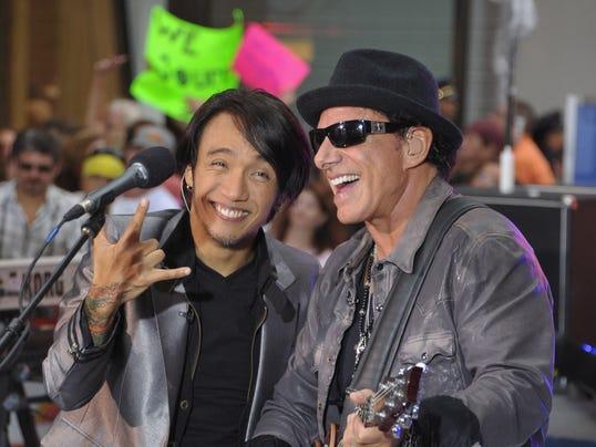 Singer Arnel Pineda and guitarist Neal Schon of Journey