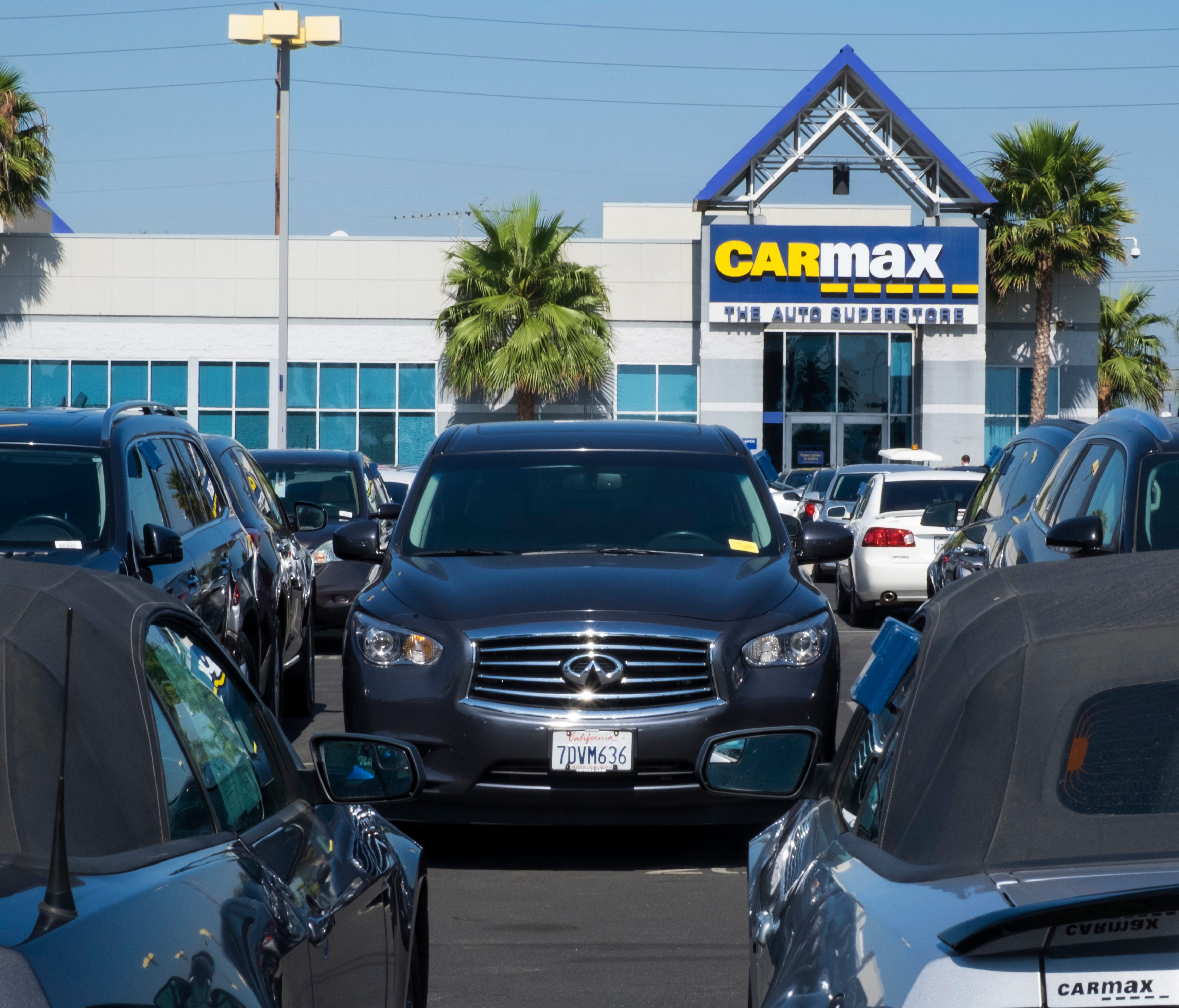 This June 28, 2017, photo provided by Edmunds shows the lot of a CarMax used-car