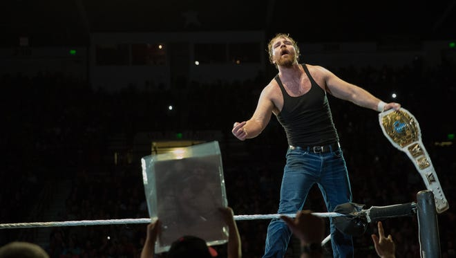 Dean Ambrose, celebrates retaining the Intercontinental Championship during WWE Smackdown Live at the Pan American Center, Saturday, February 11, 2017.