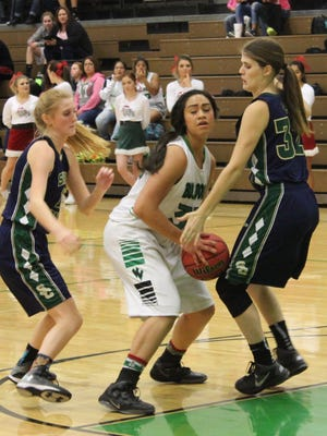 Bernice Fiso battles for control of the ball from Snow Canyon's Lindsy McConnell during a recent game.