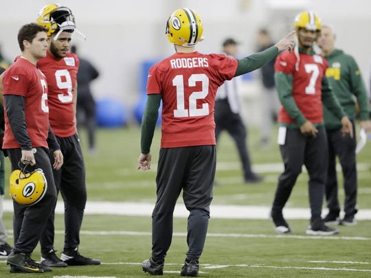 Green Bay Packers quarterback Aaron Rodgers (12) talks to quarterback Joe Callahan (6) and quarterback Jerod Evans (9) during practice at the Don Hutson Center on Wednesday, December 6, 2017 in Ashwaubenon, Wis.