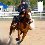 Riding for the South Lyon varsity equestrian team is