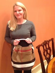 Go Burberry The upcoming Go Red Luncheon has challenged local ladies to procure fabulous, gorgeous, unusual, sophisticated bags for their signature handbag auction. Kay Cox is making a statement with her gift of a Burberry bucket bag. This Feb. 17 event is just around the corner and there are a few seats available. Call Malissa at 270-929-9585 to secure your seat.
