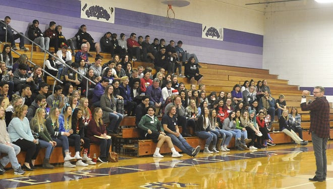 Motivational speaker Stu Cabe speaks to a small audience at Yerington High School Friday. Almost half of the school's roughly 400 students didn't attend after rumors of a school shooting.