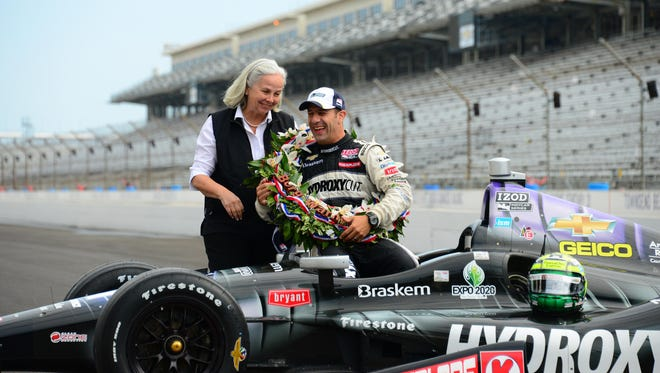 """Following his 2013 Indianapolis 500 win, Tony Kanaan laughs with his longtime friend and assistant Christine Garcia-Concheso, better known to the racing world as """"Kika."""""""