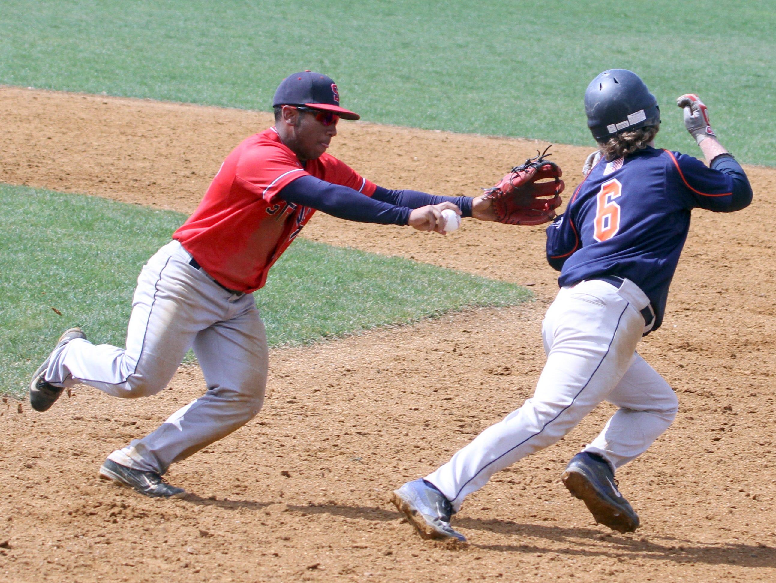 Satchel Schultz of Horace Greeley evades the tag of Stepinac second baseman Richie Wells during the championship game of the Pat Flaherty Memorial baseball tournament at Suffern High School April 2, 2016. Horace Greeley defeated Stepinac 12-0.