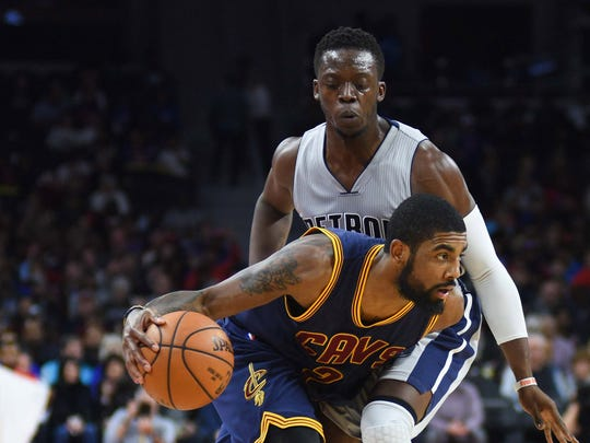 Cavaliers guard Kyrie Irving drives against Pistons guard Reggie Jackson at the Palace.