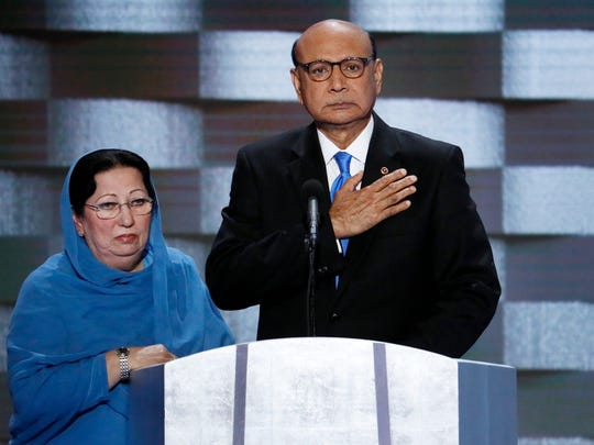In this Thursday, July 28, 2016 file photo, Khizr Khan, father of fallen US Army Capt. Humayun S. M. Khan and his wife Ghazala speak during the final day of the Democratic National Convention in Philadelphia.