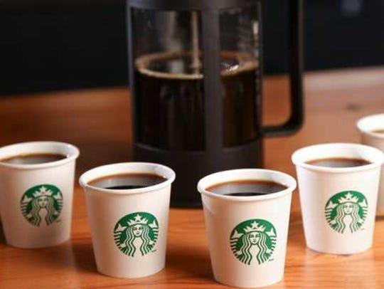 Cups of Starbucks coffee.