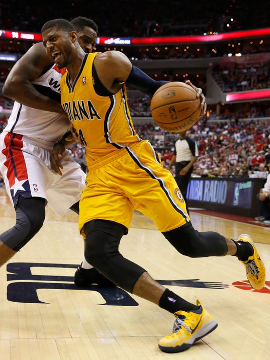 Indiana Pacers forward Paul George, front,  drives past Washington Wizards forward Martell Webster during the second half of Game 4 of an Eastern Conference semifinal NBA basketball playoff game in Washington, Sunday, May 11, 2014. (AP Photo/Alex Brandon)