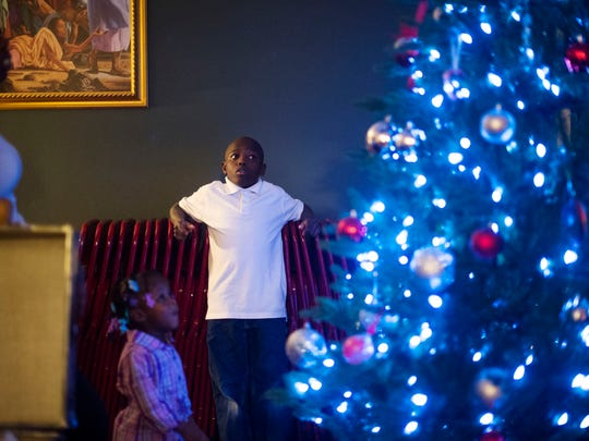Malachai Paulateer, 12, tries to decide which Christmas