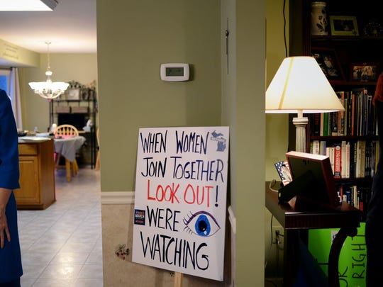 A completed sign stands in the corner on Sunday, Jan. 8, 2017 at a sign-making party at a home in Novi. The women made protest signs for the upcoming Women's March on Washington.