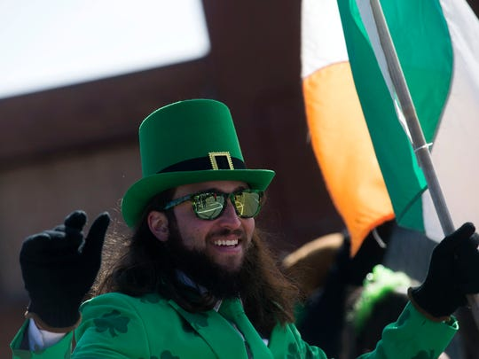 Brian Gould, of Plymouth, waves at the crowd during the 59th annual St. Patrick's Parade on Sunday, March 12, 2017 on Michigan Avenue in Detroit.