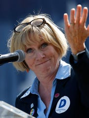 Democratic gubernatorial candidate Cathy Glasson speaks Saturday, Sept. 30, 2017, at the Polk County Steak Fry at Water Works Park in Des Moines.