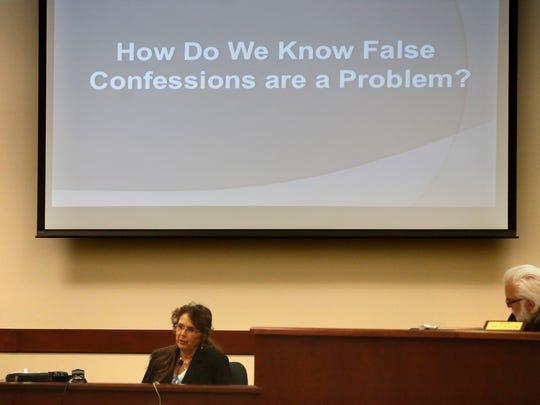 At left, Deborah Davis speaks as Judge John Dean listens