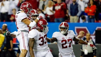 Alabama Crimson Tide linebacker Anfernee Jennings (33) celebrates a tackle with teammates during the second quarter of the SEC Championship.