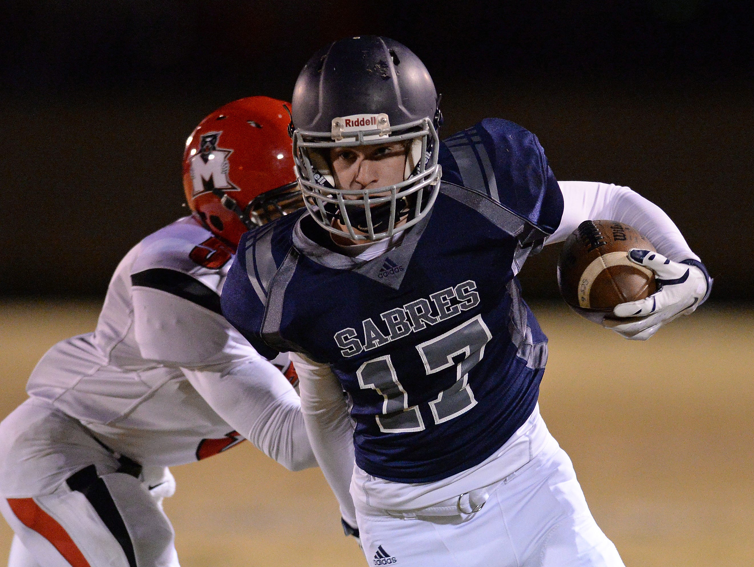 Southside Christian's Jon Taylor (17) carries past McBee's Chandler Linton (5) during the Class A Division I playoffs Friday, November 27, 2015.