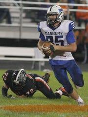 Danbury's Justin Tibbels evades Gibsonburg's Andrew Kreais.