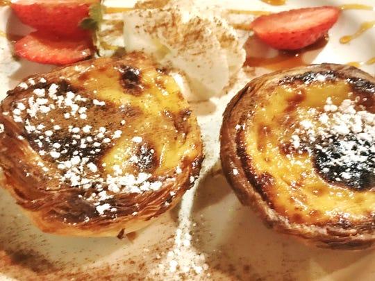 Fernando's Dockside Grille's Pastel de Nata, an egg tart pastry custard nestled inside what tasted like French toast.