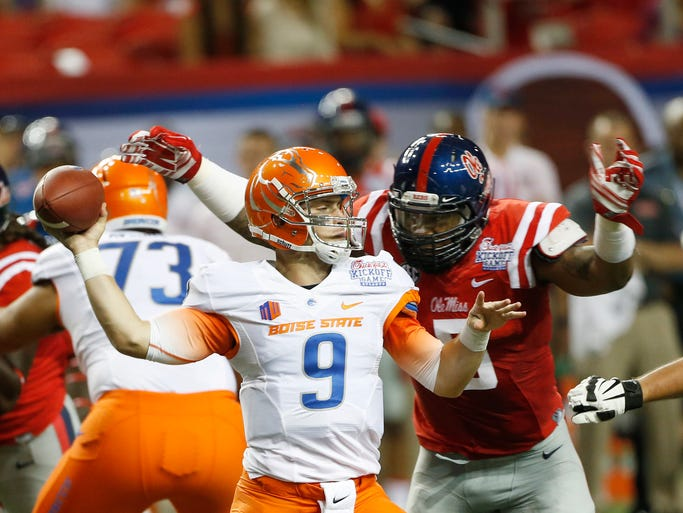 Boise State quarterback Grant Hedrick (9) throws under pressure from Ole Miss defensive tackle Robert Nkemdiche (5)) in the first half of an NCAA college football game, Thursday, Aug. 28, 2014, in Atlanta.  (AP Photo/John Bazemore)