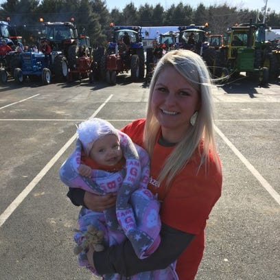 Amber Harrison holds her 8-month-old daughter, Hazel,