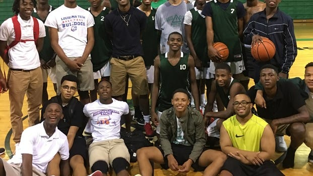 Bossier coach Nick Bohanan in center with the Bearkat team.