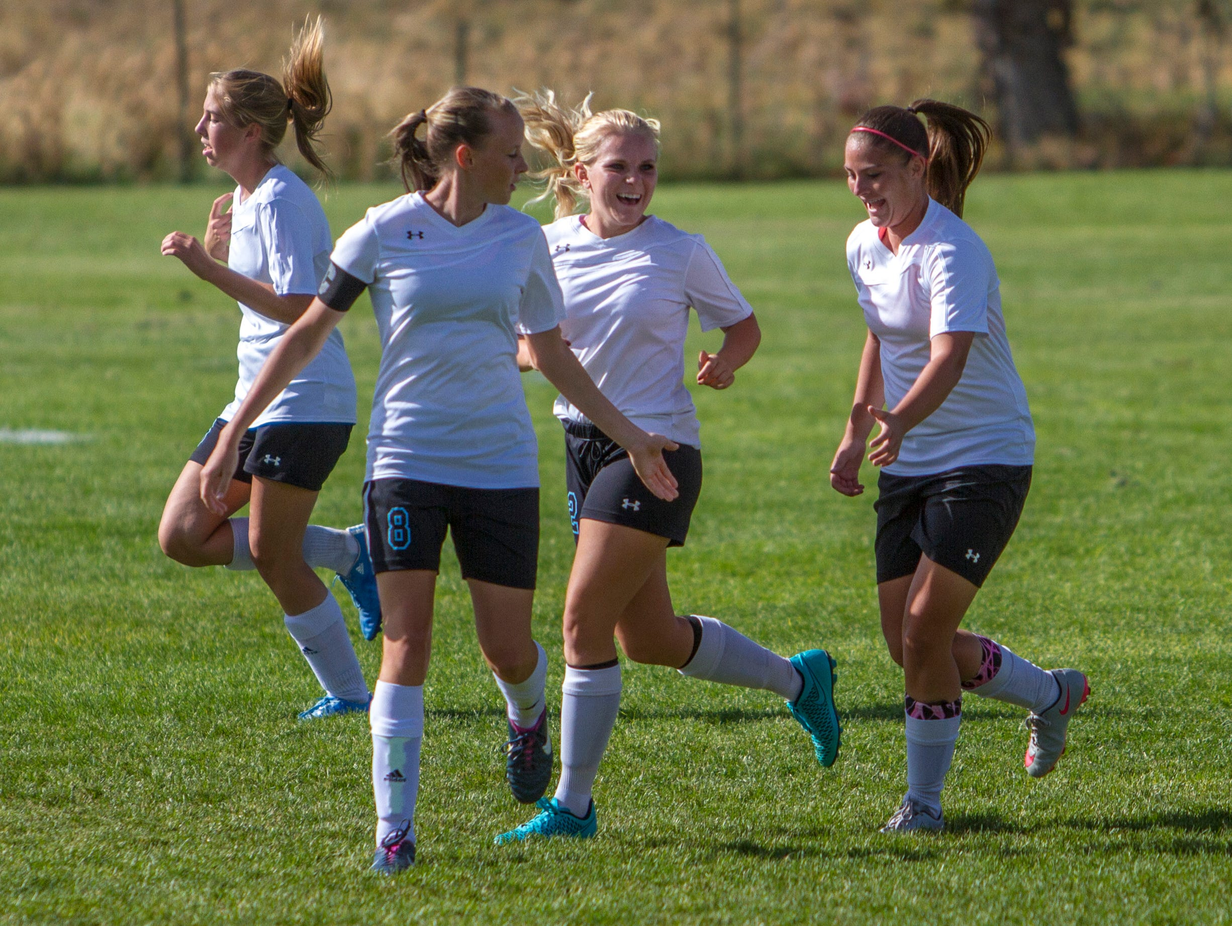 Canyon View's Ryane Caldwell celebrates with her teammates after scoring the Falcons first goal of the game against Carbon, Thursday, Oct. 8, 2015.