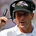 Baltimore Ravens coach John Harbaugh works against the Carolina Panthers in Baltimore on Sunday, Sept. 28, 2014.