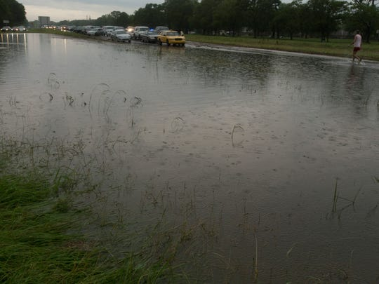 Cars stranded at a flooded section of Interstate 49 at the Grand Coteau exit as flash floods swept through Acadiana Sunday.
