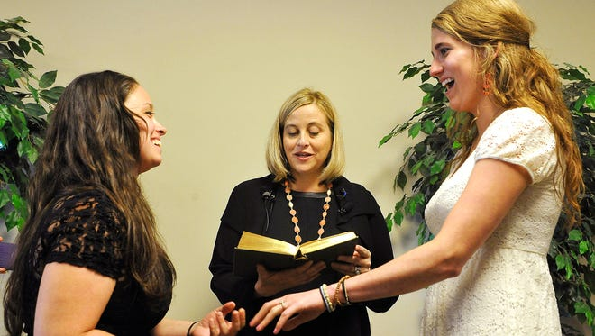 Megan Barry performed the first same-sex marriage between Lauren Mesnard, 25, and Nikki VonHaeger, 26, after the U.S. Supreme Court overturned state bans on same-sex marriage in June 2015. Attorneys who defeated the ban are still battling with the state to recoup their fees.