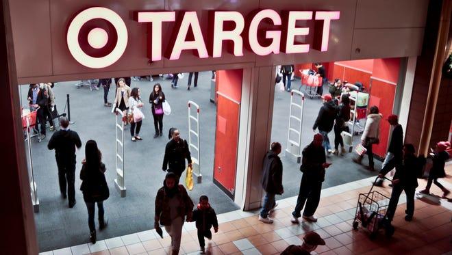 Shoppers visit Target on Nov. 23, 2013, in New York.