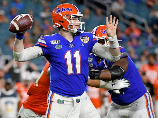 Dec 30, 2019; Miami Gardens, Florida, USA; Florida Gators quarterback Kyle Trask (11) attempts a pass against the Virginia Cavaliers during the first half at Hard Rock Stadium. Mandatory Credit: Jasen Vinlove-USA TODAY Sports