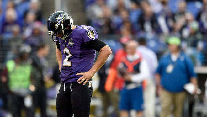 Baltimore quarterback Jimmy Clausen reacts during Sunday's loss to Seattle.