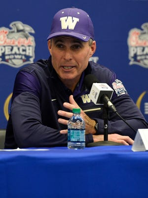 Washington Huskies head coach Chris Petersen speaks at a press conference after the game against the Alabama Crimson Tide in the 2016 CFP Semifinal at the Georgia Dome. Alabama defeated Washington 24-7.