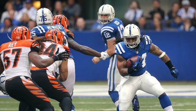 Colts running back Trent Richardson breaks through a huge hole  in the first half against Cincinnati at Lucas Oil Stadium on October 19, 2014. The Colts won 27-0.