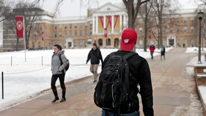Students walk on Bascom Hill at the University of Wisconsin in Madison.