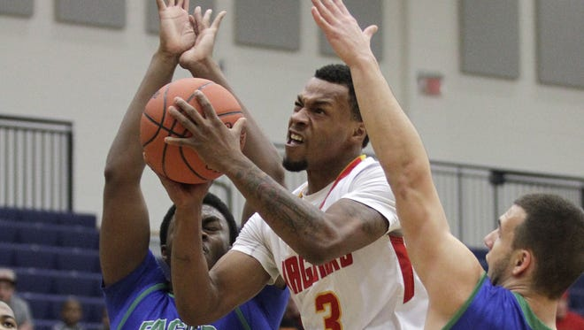 Schroder's Anthony Brown fights through traffic in the paint.