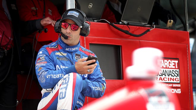 Chip Ganassi Racing's Tony Kanaan (10) sit on teammate Scott Dixon's pit wall during practice for the Indianapolis 500, May 14, at the Indianapolis Motor Speedway.