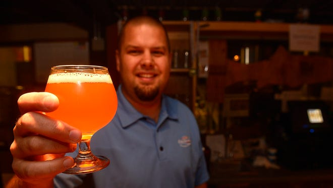 Clint Nissen of Lolo won the Mighty Mo's home brewing contest with his beer called Smurf. He was on hand at the brewery Friday for its release to the public.