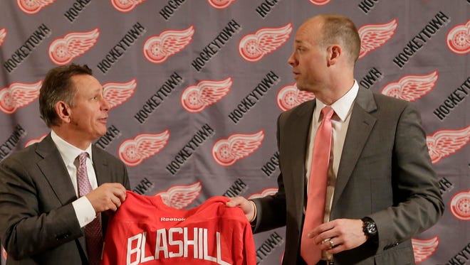 New Red Wings coach Jeff Blashill, right, is introduced by general manager Ken Holland at Joe Louis Arena on June 9, 2015.