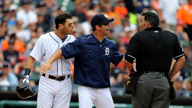 Detroit Tigers manager Brad Ausmus and second baseman Ian Kinsler argue with home plate umpire Manny Gonzalez during third-inning action against the Baltimore Orioles on Sunday, July 19, 2015 at Comerica Park in Detroit.