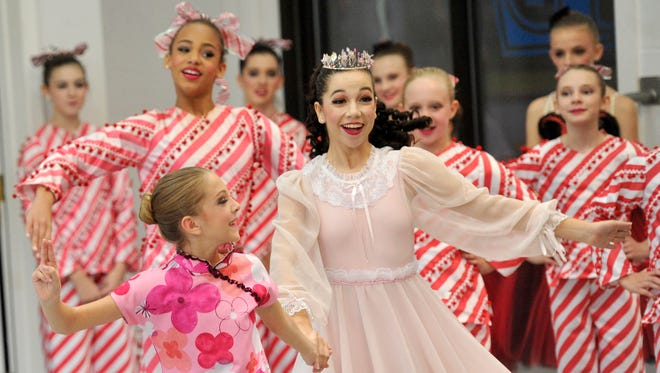 Abigail Miller, center, portraying Clara in the Greater York Dance Studio production of The Nutcracker, participates in dress rehearsal at the studio on Saturday, Nov. 14 , 2015.