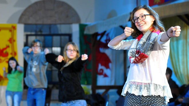 Adrianna Irvine, 16, (front) who plays Lady Percy and the Earl of Westmorland, demonstrates warmups as the Belt Valley Shakespeare Players give students from Belt Elementary an inside look at how they are preparing for their Henry IV production Wednesday morning at the Belt Theater. The theater group will perform the show this weekend in Belt and in May at the Shakespeare's First Folio exhibit hosted by the University of Montana.