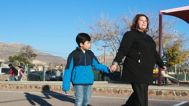 Anna Aleman escorted son Camilo Salazar, 7, to his classroom Wednesday at Coldwell Elementary School Wednesday. Parents Anna Aleman and Louie Salazar decided to transfer their son from Rusk to Coldwell to allow him to participate in the dual-language program at Coldwell.
