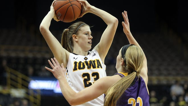 Iowa's Christina Buttenham looks for an open teammate during the Hawkeyes' game against Western Illinois at Carver-Hawkeye Arena on Thursday, Nov. 19, 2015.