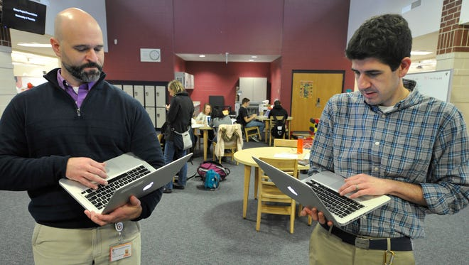 Central York High School teachers, Wes Ward, left, and Greg Wimmer go over scheduling during a morning session of the Apollo class they run. Teachers said the class offered them more time to interact with students.