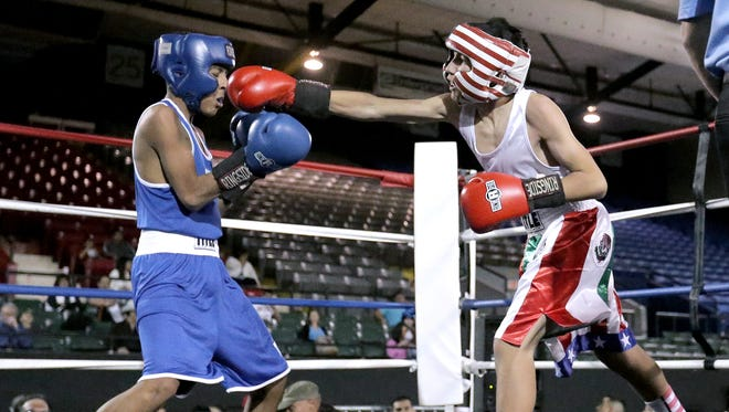 George Monclova, right, of Alpine Boxing defeated Joe Pabon of Rodriguez Fight Team Saturday in their 95-pound bout at the Golden Gloves Championships at the El Paso County Coliseum.