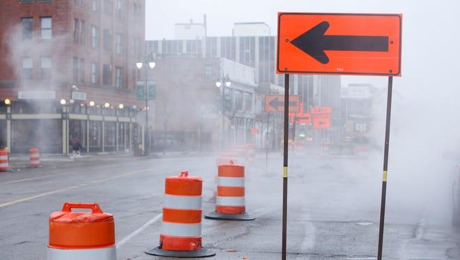 Construction barrels and sign.